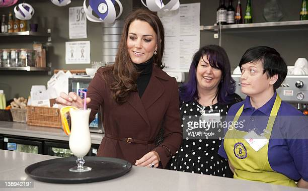 Catherine Duchess of Cambridge behind the bar with Jacquie JohnstonLynch Merseyside head of service for Action on Addiction and Paula Carey making a...
