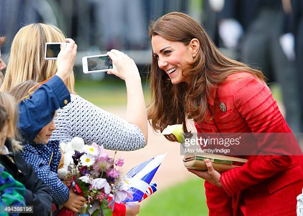 Catherine Duchess of Cambridge being photographed members of the public whilst on a walkabout in MacRosty Park on a day of engagements in Strathearn...