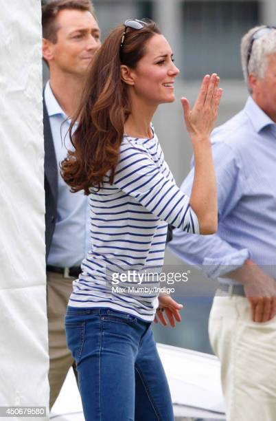 Catherine Duchess of Cambridge blows a kiss whilst watching Prince William Duke of Cambridge Prince Harry play in the Jerudong Trophy charity polo...