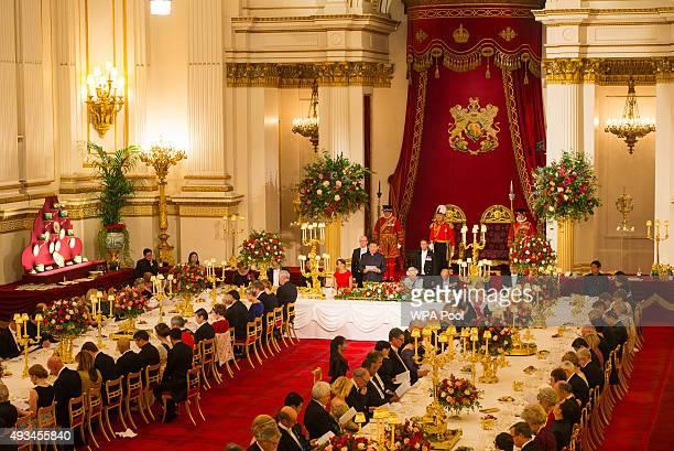 Catherine Duchess of Cambridge Britain's Queen Elizabeth II and Prince Philip Duke of Edinburgh listen as President of China Xi Jinping speaks during...