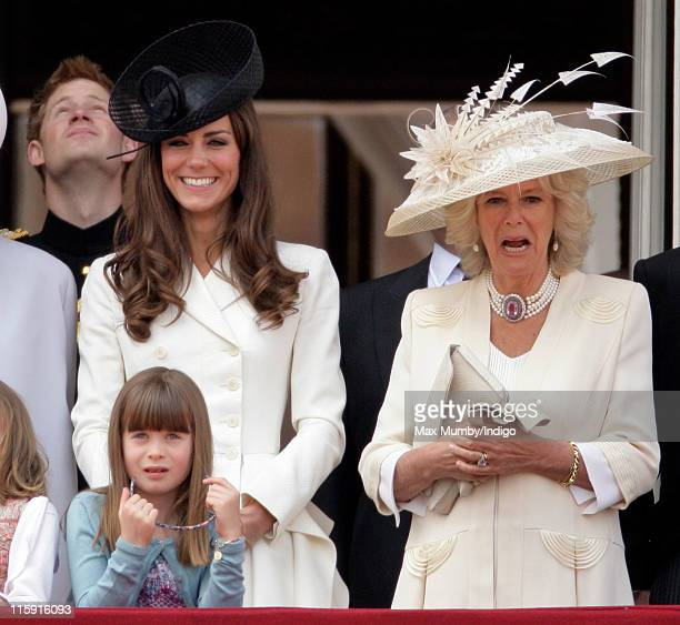 Catherine Duchess of Cambridge Camilla Duchess of Cornwall and Eloise Taylor stand on the balcony of Buckingham Palace after the Trooping the Colour...