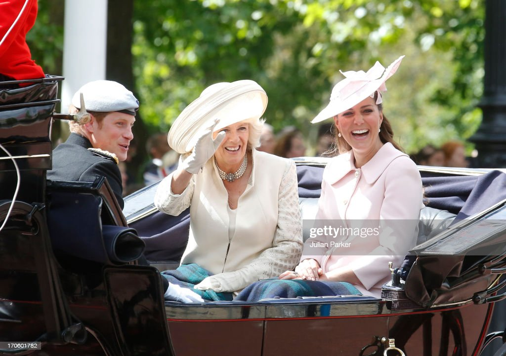 Catherine, Duchess of Cambridge, <a gi-track='captionPersonalityLinkClicked' href=/galleries/search?phrase=Camilla+-+Duchess+of+Cornwall&family=editorial&specificpeople=158157 ng-click='$event.stopPropagation()'>Camilla</a>, Duchess of Cornwall, and <a gi-track='captionPersonalityLinkClicked' href=/galleries/search?phrase=Prince+Harry&family=editorial&specificpeople=178173 ng-click='$event.stopPropagation()'>Prince Harry</a> travel by carriage along The Mall to the annual Trooping The Colour ceremony at Horse Guards Parade on June 15, 2013 in London, England.