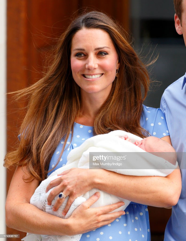 <a gi-track='captionPersonalityLinkClicked' href=/galleries/search?phrase=Catherine+-+Duchess+of+Cambridge&family=editorial&specificpeople=542588 ng-click='$event.stopPropagation()'>Catherine</a>, Duchess of Cambridge carries her newborn son as she and Prince William, Duke of Cambridge leave The Lindo Wing at St Mary's Hospital on July 23, 2013 in London, England. The Duchess of Cambridge yesterday gave birth to a boy at 16.24 BST and weighing 8lb 6oz, with Prince William at her side. The baby, as yet unnamed, is third in line to the throne and becomes the Prince of Cambridge.