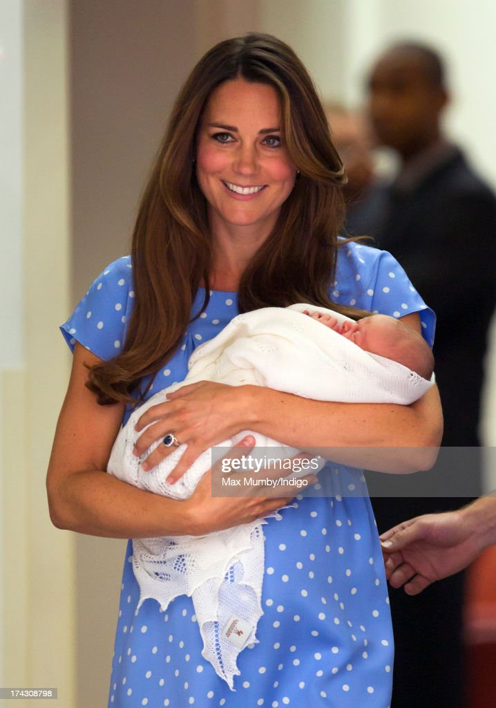 Catherine, Duchess of Cambridge carries her newborn son as she and Prince William, Duke of Cambridge leave The Lindo Wing at St Mary's Hospital on July 23, 2013 in London, England. The Duchess of Cambridge yesterday gave birth to a boy at 16.24 BST and weighing 8lb 6oz, with Prince William at her side. The baby, as yet unnamed, is third in line to the throne and becomes the Prince of Cambridge.