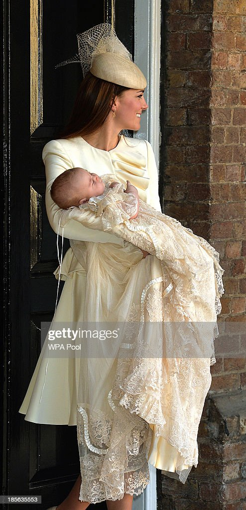 Catherine, Duchess of Cambridge carries her son Prince George Of Cambridge after his christening at the Chapel Royal in St James's Palace on October 23, 2013 in London, England.