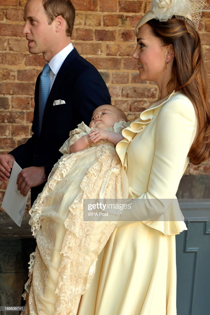 Catherine, Duchess of Cambridge carries her son Prince George Of Cambridge alongside Prince William, Duke of Cambridge, following his christening at the Chapel Royal in St James's Palace on October 23, 2013 in London, England.