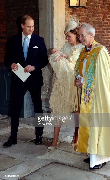 Catherine Duchess of Cambridge carries her son Prince George Of Cambridge with Prince William Duke of Cambridge as they leave the Chapel Royal...