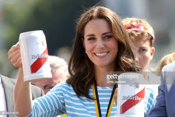 Catherine Duchess of Cambridge celebrates with a beer after participating in a rowing race between the twinned town of Cambridge and Heidelberg and...