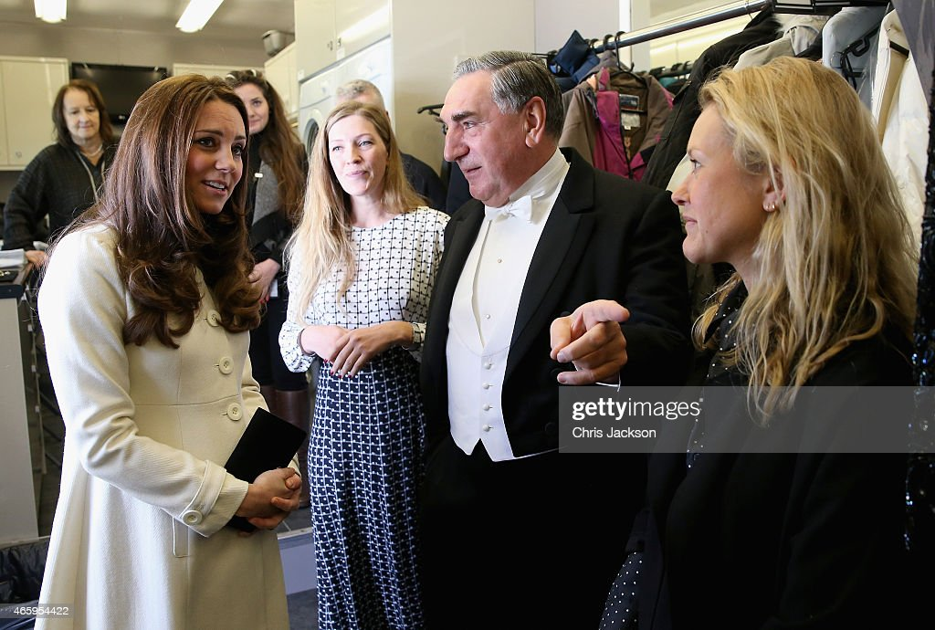 Catherine, Duchess of Cambridge chats to actor Jim Carter (Carson) during an official visit to the set of Downton Abbey at Ealing Studios on March 12, 2015 in London, England.