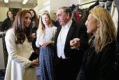 Catherine Duchess of Cambridge chats to actor Jim Carter during an official visit to the set of Downton Abbey at Ealing Studios on March 12 2015 in...