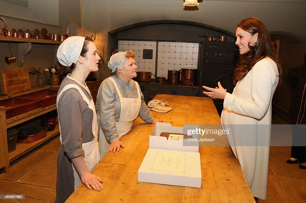 Catherine, Duchess of Cambridge chats to actresses Sopie McShera and Lesley Nicol during an official visit to the set of Downton Abbey at Ealing Studios on March 12, 2015 in London, England.