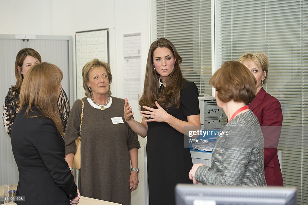 Catherine, Duchess of Cambridge chats to the bereavement services team as she visits the offices of Child Bereavement UK on March 19, 2013 in Saunderton, Buckinghamshire.