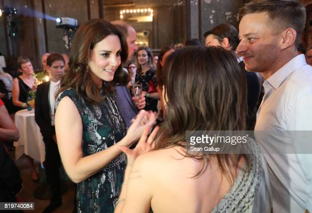 Catherine Duchess of Cambridge chats with German actress Jana Pallaske and actor Thomas Wlaschiha at a reception at Claerchen's Ballhaus dance hall...