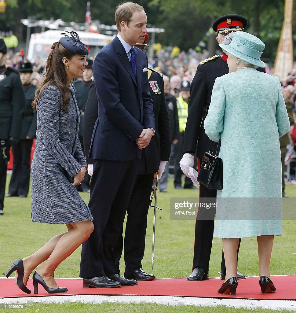 Catherine, Duchess of Cambridge curtsies as her and her husband <a gi-track='captionPersonalityLinkClicked' href=/galleries/search?phrase=Prince+William&family=editorial&specificpeople=178205 ng-click='$event.stopPropagation()'>Prince William</a>, Duke of Cambridge bid farewell to Queen <a gi-track='captionPersonalityLinkClicked' href=/galleries/search?phrase=Elizabeth+II&family=editorial&specificpeople=67226 ng-click='$event.stopPropagation()'>Elizabeth II</a> after visiting Vernon Park during a Diamond Jubilee visit to Nottingham on June 13, 2012 in Nottingham, England.