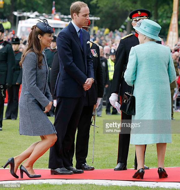 Catherine Duchess of Cambridge curtsies as her and her husband Prince William Duke of Cambridge bid farewell to Queen Elizabeth II after visiting...