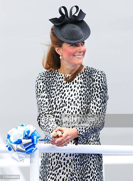 Catherine Duchess of Cambridge cuts a rope to smash a bottle of Champagne on the hull of the new Princess Cruises ship 'Royal Princess' during the...