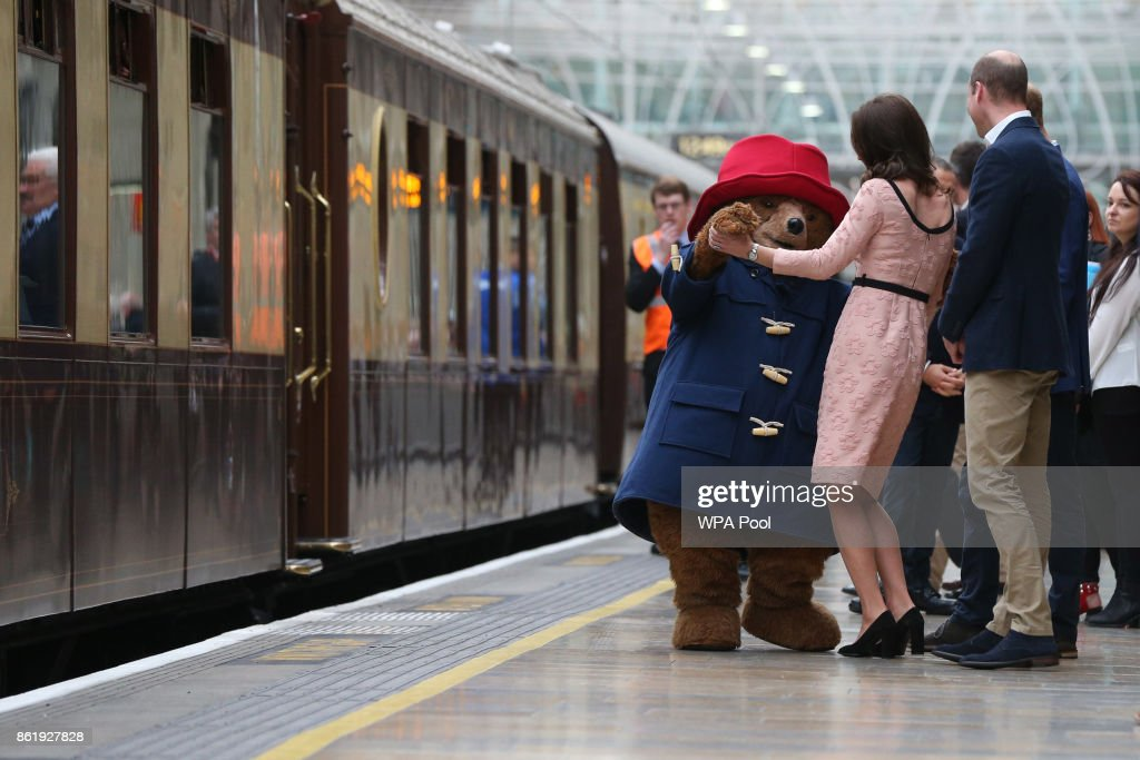 Catherine, Duchess of Cambridge dances with Paddington bear on platform 1 at Paddington Station as she meets the cast and crew from the forthcoming film Paddington 2 at Paddington Station on October 16, 2017.