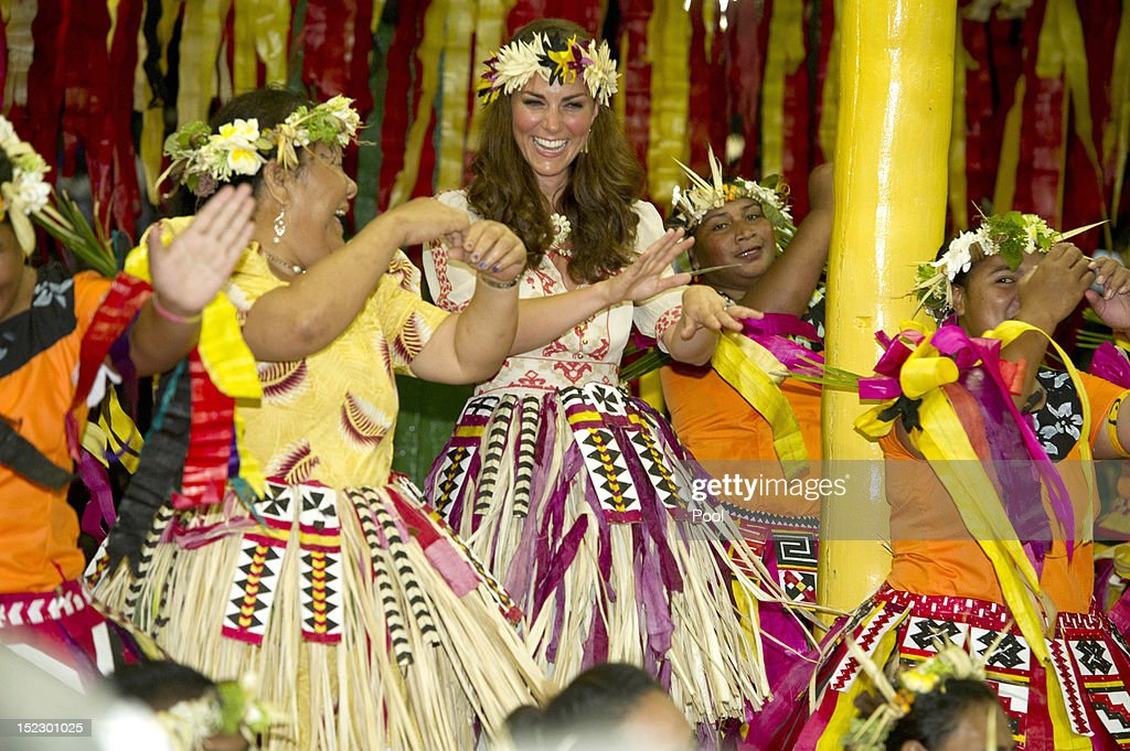 <a gi-track='captionPersonalityLinkClicked' href=/galleries/search?phrase=Catherine+-+Duchess+of+Cambridge&family=editorial&specificpeople=542588 ng-click='$event.stopPropagation()'>Catherine</a>, Duchess of Cambridge dances with the ladies at the Vaiku Falekaupule for an entertainment programme on September 18, 2012 in Tuvalu. Prince William, Duke of Cambridge and <a gi-track='captionPersonalityLinkClicked' href=/galleries/search?phrase=Catherine+-+Duchess+of+Cambridge&family=editorial&specificpeople=542588 ng-click='$event.stopPropagation()'>Catherine</a>, Duchess of Cambridge are on a Diamond Jubilee tour representing the Queen taking in Singapore, Malaysia, the Solomon Islands and Tuvalu.