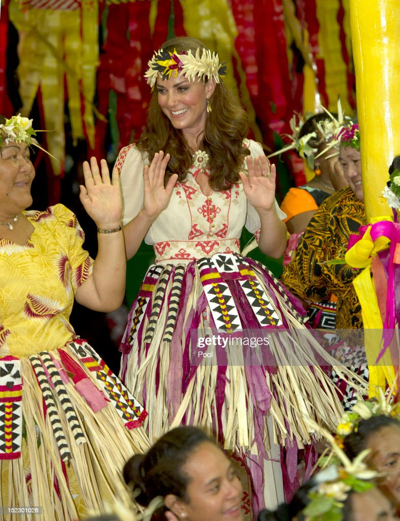 Catherine, Duchess of Cambridge dances with the ladies at the Vaiku Falekaupule for an entertainment programme on September 18, 2012 in Tuvalu. Prince William, Duke of Cambridge and Catherine, Duchess of Cambridge are on a Diamond Jubilee tour representing the Queen taking in Singapore, Malaysia, the Solomon Islands and Tuvalu.