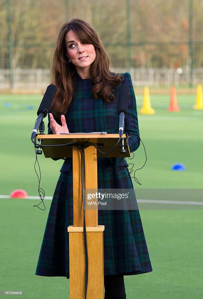 Catherine, Duchess of Cambridge delivers a speech during her visit to St Andrew's School on November 30, 2012 in Pangbourne, Berkshire, England. The Duchess visited the Pre-Prep School for under-5s, unveiled a plaque to officially open a new artificial turf playing field and met members of the school's hockey team, which she played for during her time as a pupil at the school (1986-1995). The Duchess also toured the school privately and watched the school's Progressive Games which are traditional games played indoors by teachers and students as part of activities to mark St Andrew's Day.