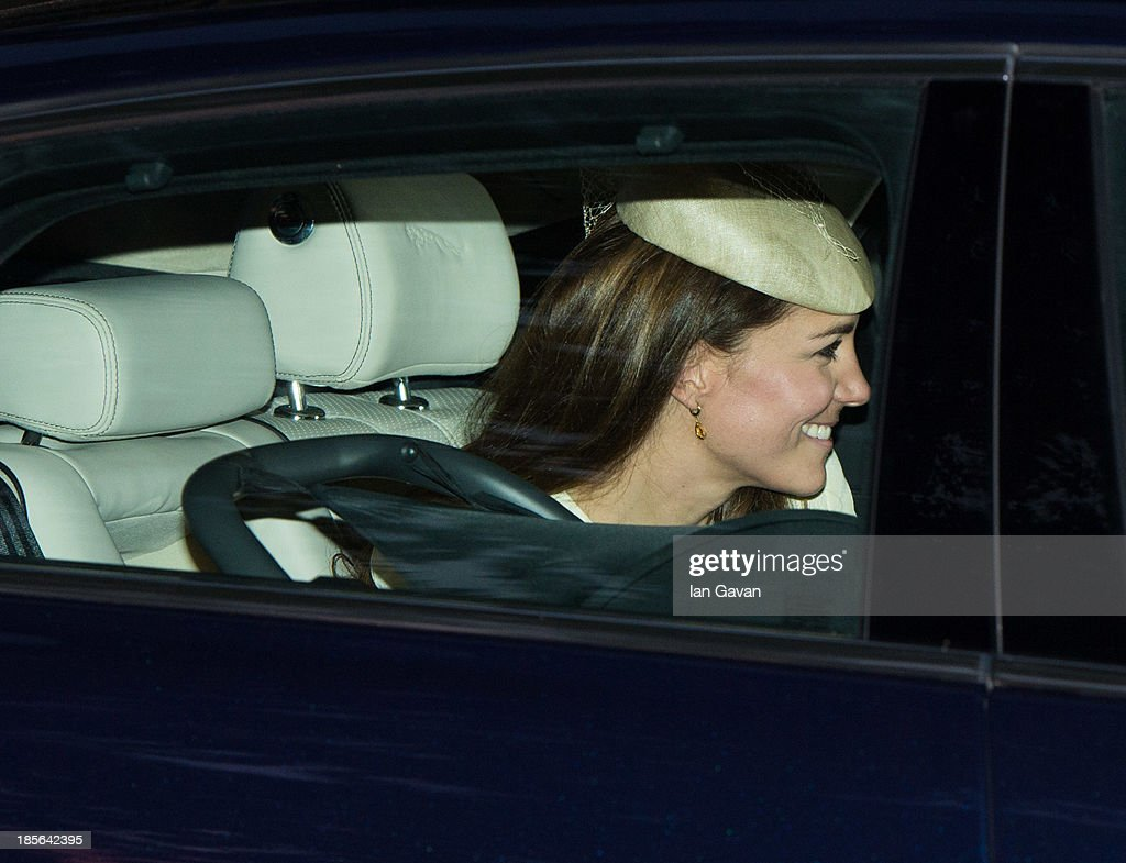 Catherine Duchess of Cambridge departs from attending Prince George's christening at St James' Palace on October 23, 2013 in London, England.
