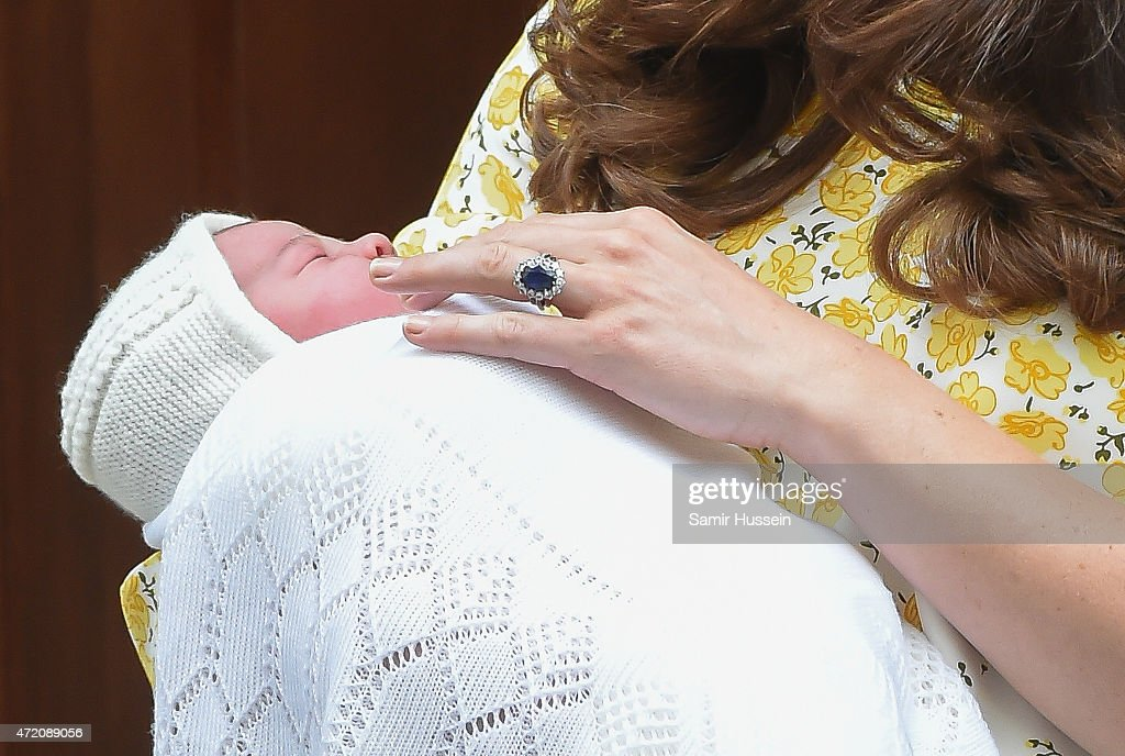 Catherine Duchess of Cambridge departs the Lindo Wing with her newborn baby daughter at St Mary's Hospital on May 2 2015 in London England