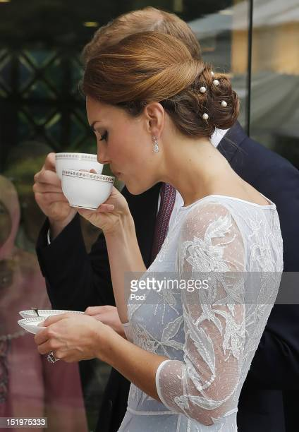 Catherine Duchess of Cambridge drinks tea at the British High Commission on day 4 of Prince William Duke of Cambridge and Catherine Duchess of...