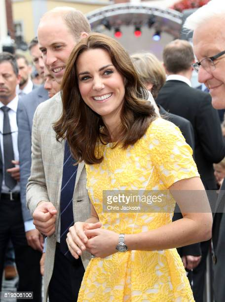 Catherine Duchess of Cambridge during a tour of a traditional German market in the Central Square with Prince William Duke of Cambridge on day 2 of...