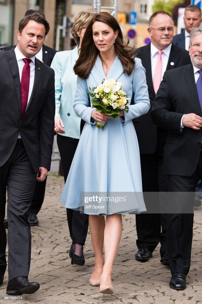 Catherine, Duchess of Cambridge (R) escorted by Xavier Bettel, Prime Minister of Luxembourg (L), tours a cycling themed festival and unveils a mural of British cyclist Tom Simpson and Luxembourgish cycling legend Charly Gaul during a one day visit to Luxembourg at Place de Clairfontaine on May 11, 2017 in Luxembourg, Luxembourg.