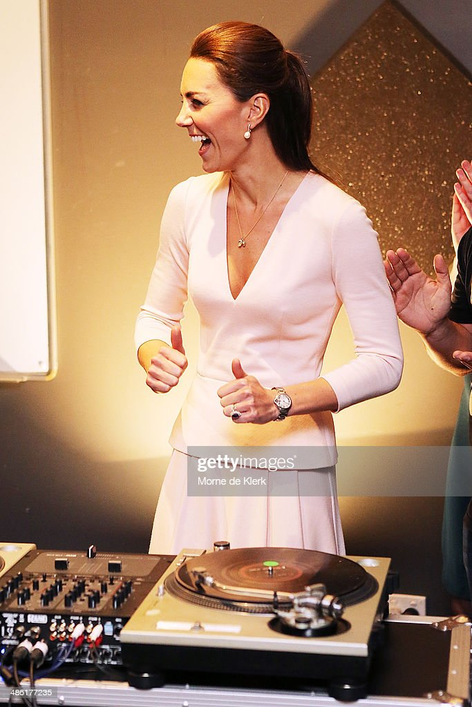 Catherine, Duchess of Cambridge gestures after she used the DJ decks at the youth community centre, The Northern Sound System, in Elizabeth on April 23, 2014 in Adelaide, Australia. The Duke and Duchess of Cambridge are on a three-week tour of Australia and New Zealand, the first official trip overseas with their son, Prince George of Cambridge.