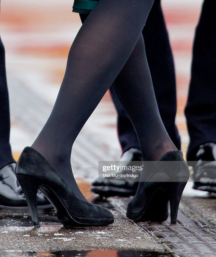Catherine, Duchess of Cambridge gets the heel of her shoe stuck in a grate as she attends the St Patrick's Day Parade at Mons Barracks on March 17, 2013 in Aldershot, England.