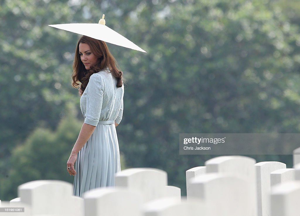 Catherine, Duchess of Cambridge glances back at war graves as she leaves Kranji Commonwealth War Cemetery on day 3 of Prince William, Duke of Cambridge and Catherine, Duchess of Cambridge's Diamond Jubilee Tour of the Far East on September 13, 2012 in Singapore. Prince William, Duke of Cambridge and Catherine, Duchess of Cambridge are on a Diamond Jubilee Tour of the Far East taking in Singapore, Malaysia, the Solomon Islands and the tiny Pacific Island of Tuvalu.