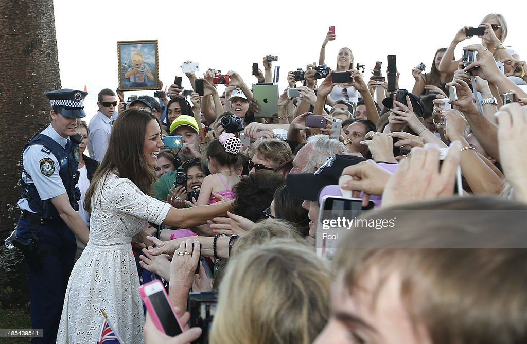 Catherine, Duchess of Cambridge greets a crowd gathered near a surf lifesaving event on Manly Beach on April 18, 2014 in Sydney, Australia. The Duke and Duchess of Cambridge are on a three-week tour of Australia and New Zealand, the first official trip overseas with their son, Prince George of Cambridge.