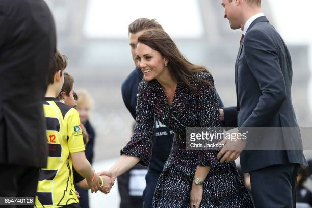 Catherine Duchess of Cambridge greets a school kid at the Trocadero during an official twoday visit to Paris on March 18 2017 in Paris France