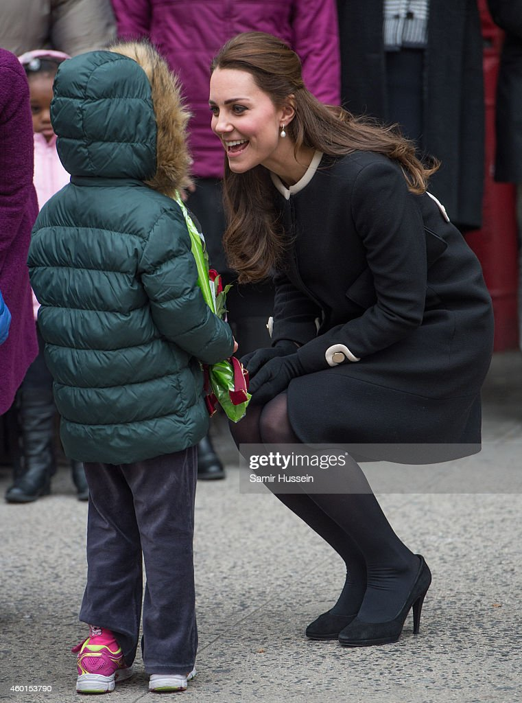 Catherine, Duchess of Cambridge greets children as she visits Northside Center for Child Development during her official two-day visit to the United States on December 8, 2014 in New York City.