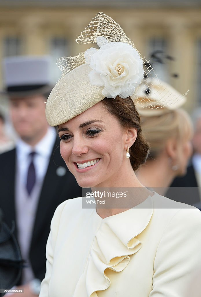 Catherine, Duchess of Cambridge greets guests attending a garden party at Buckingham Palace on May 24, 2016 in London, England.