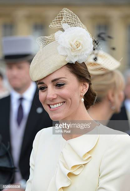 Catherine Duchess of Cambridge greets guests attending a garden party at Buckingham Palace on May 24 2016 in London England