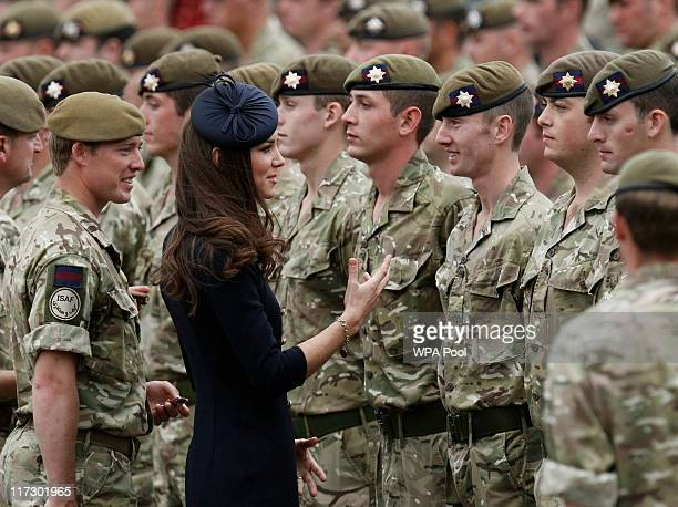 Catherine Duchess of Cambridge greets members of the 1st Battalion Irish Guards after she presented operational medals for Afghanistan on Armed...