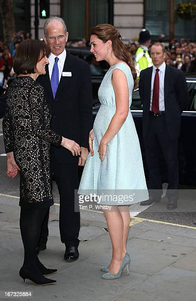 Catherine Duchess of Cambridge greets people as she attends an evening reception to celebrate the work of The Art Room charity at The National...
