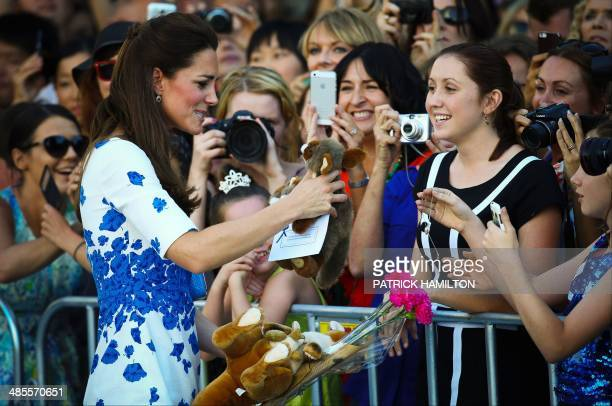 Catherine Duchess of Cambridge greets people during a visit too Southbank in Brisbane on April 19 2014 Britain's Prince William his wife Kate and...