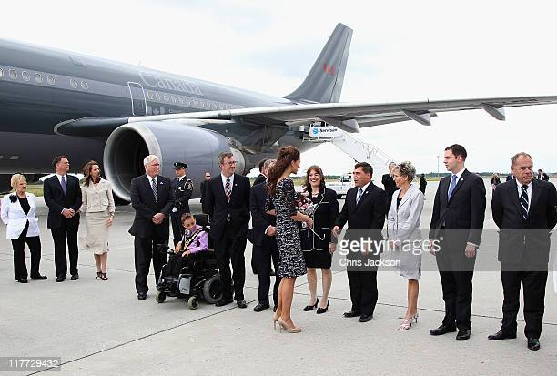 Catherine Duchess of Cambridge greets people in the lineup as she arrives at MacdonaldCartier International Airport on June 30 2011 in Ottawa Canada...