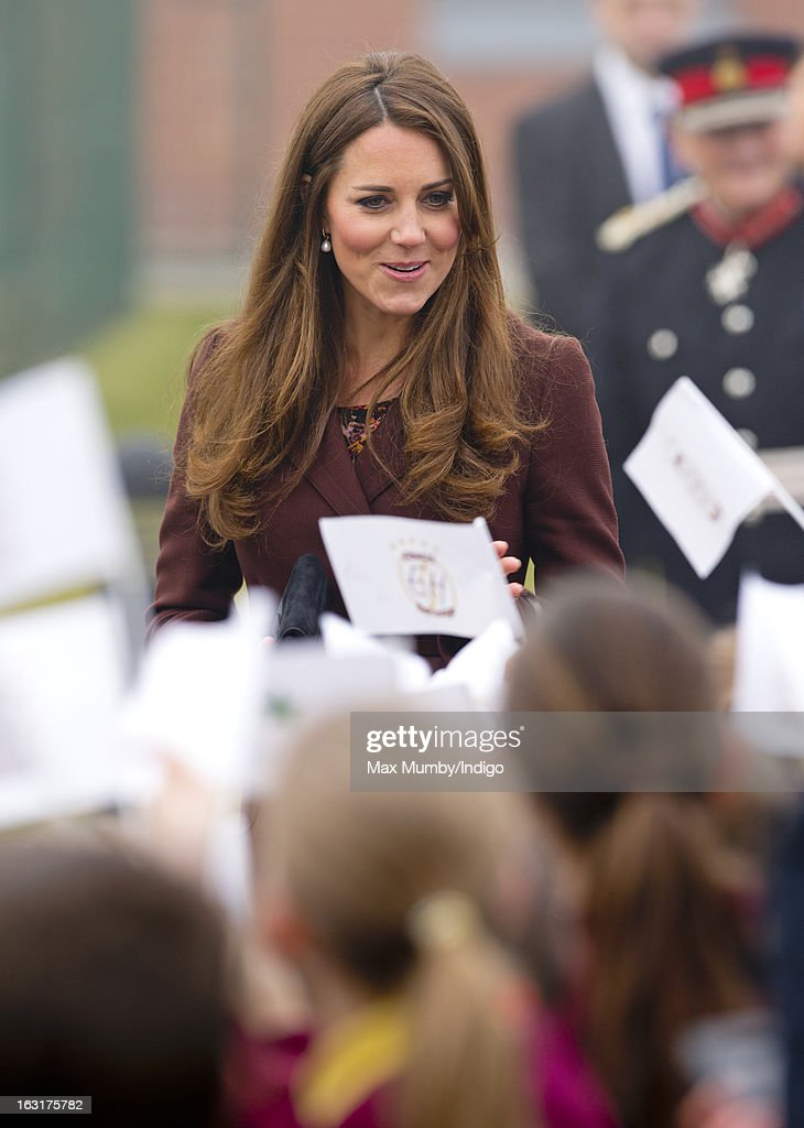 Catherine, Duchess of Cambridge greets school children as she visits Havelock Academy whilst carrying out a day of engagements on March 5, 2013 in Grimsby, England.