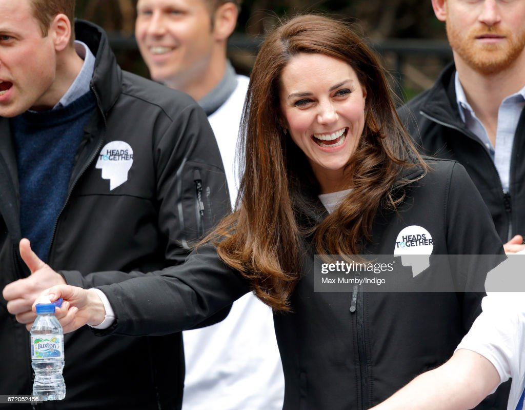 Catherine, Duchess of Cambridge hands out water to runners taking part in the 2017 Virgin Money London Marathon on April 23, 2017 in London, England. The Heads Together mental heath campaign, spearheaded by The Duke & Duchess of Cambridge and Prince Harry, is the marathon's 2017 Charity of the Year.