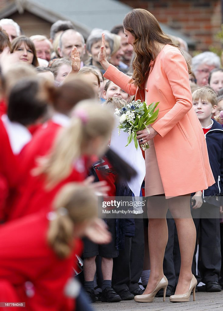 Catherine, Duchess of Cambridge 'high fives' a young child as she meets local school children on a visit to Naomi House Children's Hospice, to celebrate Children's Hospice Week 2013 on April 29, 2013 near Winchester, Hampshire, England. Today marks the second wedding anniversary of Prince William, Duke of Cambridge and Catherine, Duchess of Cambridge. They married on April 29, 2011 in Westminster Abbey.