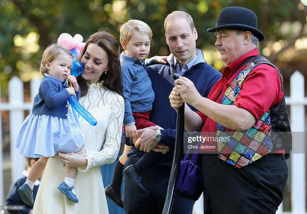 Catherine, Duchess of Cambridge holding Princess Charlotte of Cambridge and Prince George of Cambridge, being held by Prince William, Duke of Cambridge at a children's party for Military families during the Royal Tour of Canada on September 29, 2016 in Victoria, Canada. Prince William, Duke of Cambridge, Catherine, Duchess of Cambridge, Prince George and Princess Charlotte are visiting Canada as part of an eight day visit to the country taking in areas such as Bella Bella, Whitehorse and Kelowna