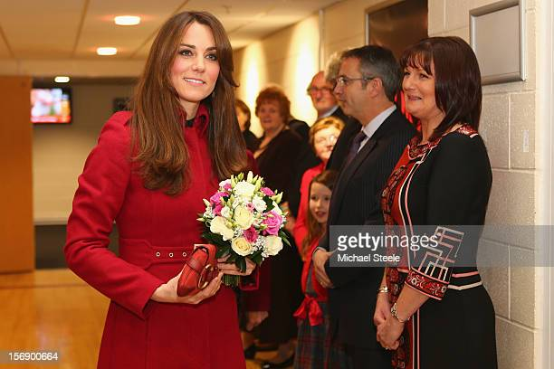 Catherine Duchess of Cambridge holds a bouquet of flowers as she arrives at the Autumn International rugby match between Wales and New Zealand at the...