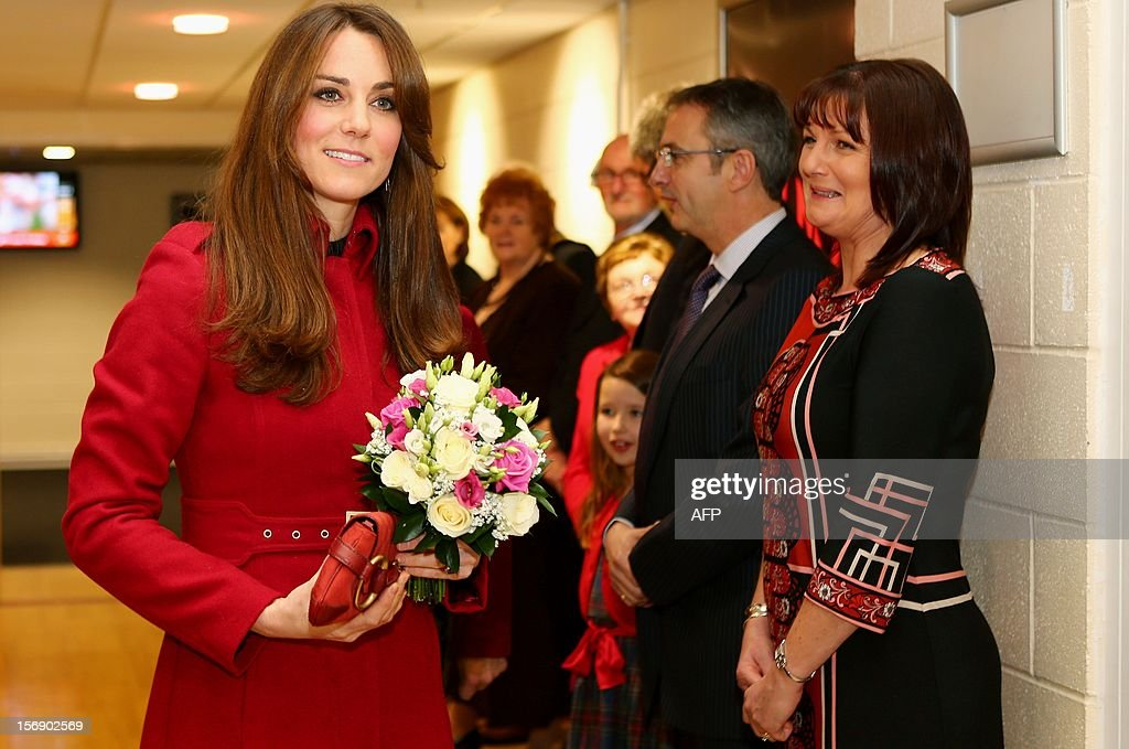 Catherine, Duchess of Cambridge holds a bouquet of flowers as she arrives at the Autumn International rugby match between Wales and New Zealand at the Millennium Stadium, Cardiff on November 24, 2012 in Cardiff, Wales. AFP PHOTO/POOL/ Michael Steele