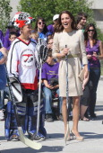 Catherine Duchess of Cambridge holds a hockey still during an official welcome ceremony at the Somba K'e Civic Plaza on July 5 2011 in Yellowknife...