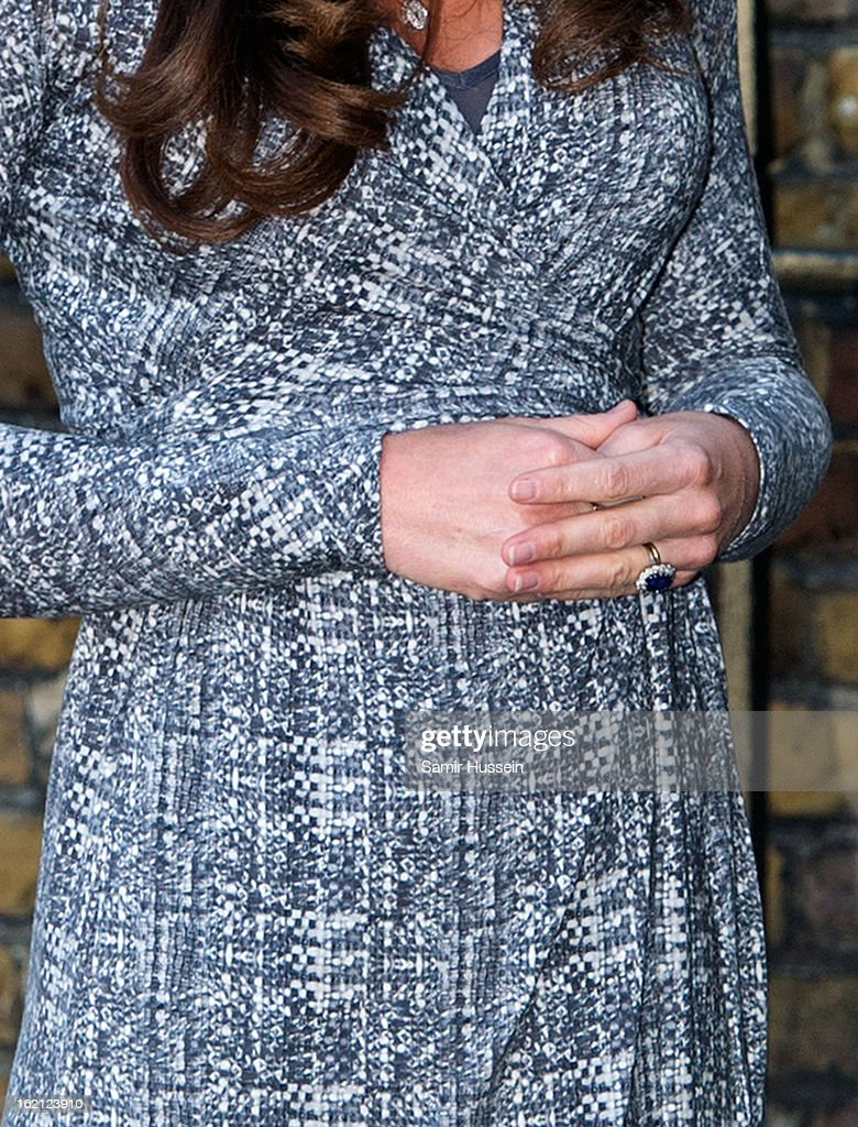 Catherine, Duchess of Cambridge holds her baby bump as she visits Hope House on February 19, 2013 in London, England.