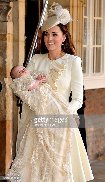 Catherine Duchess of Cambridge holds her son Prince George of Cambridge following his Christening at Chapel Royal in St James's Palace in central...